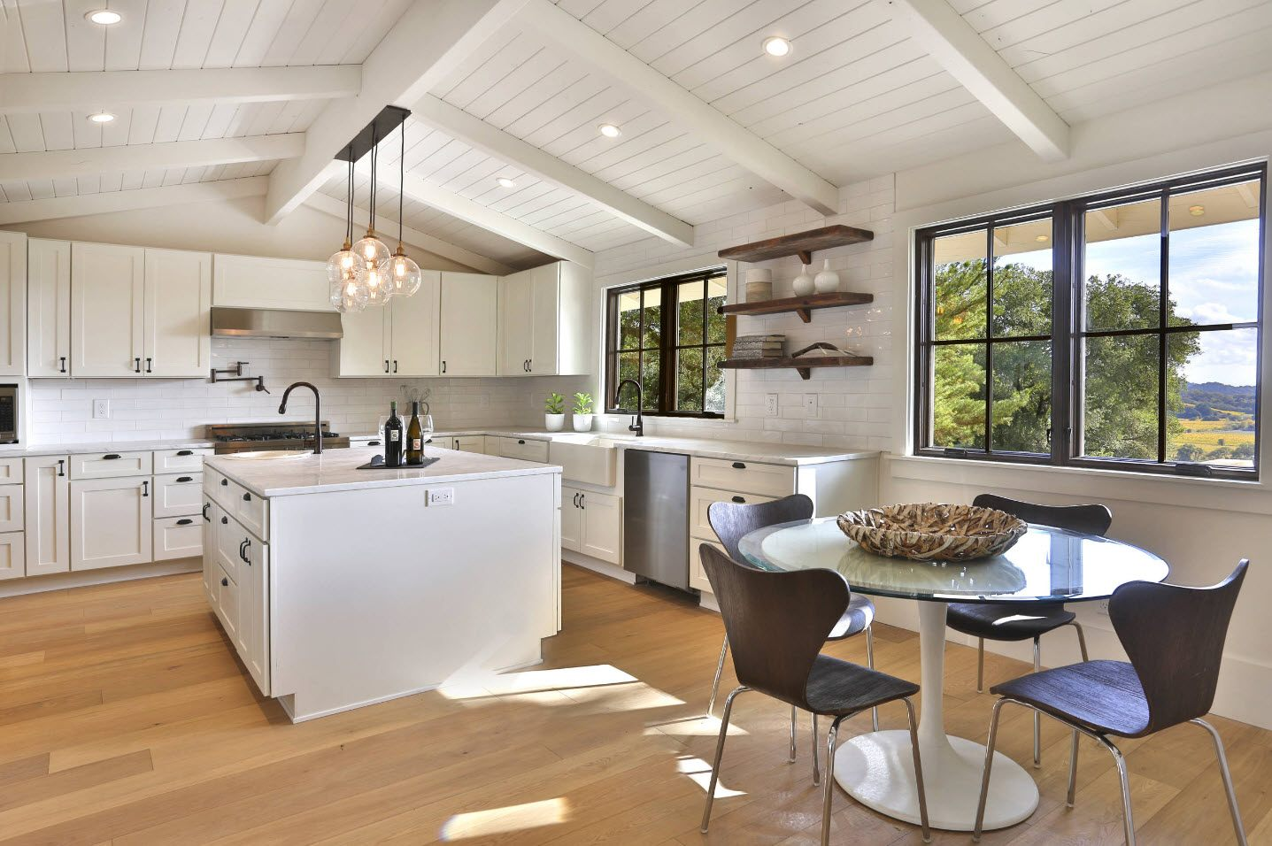 Modern loft cottage concept of the kitchen with large island and plenty of natural light