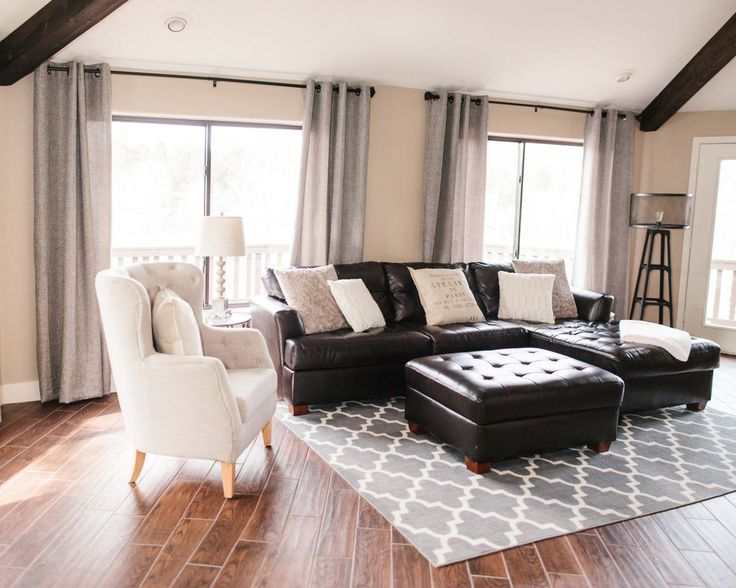Beige interior of the room with quilted black coffee table