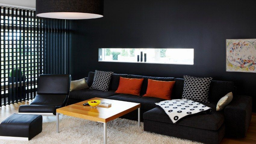 Black Sofa: Elegant and Original Design for Flawless Interior. totally black room with bright accents