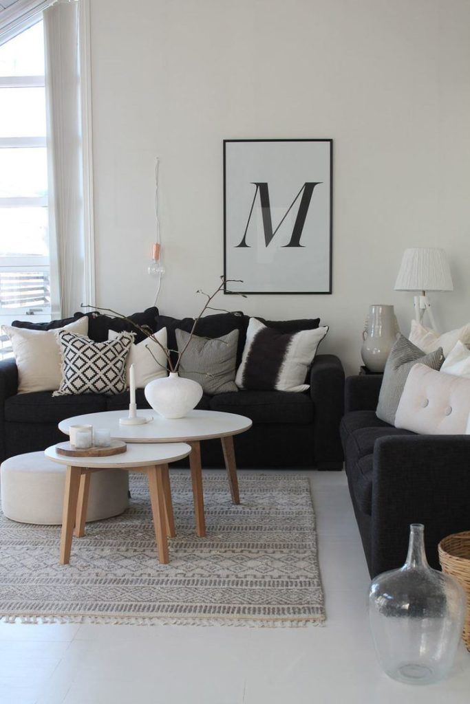Nice example of the Scandi style with black sofas