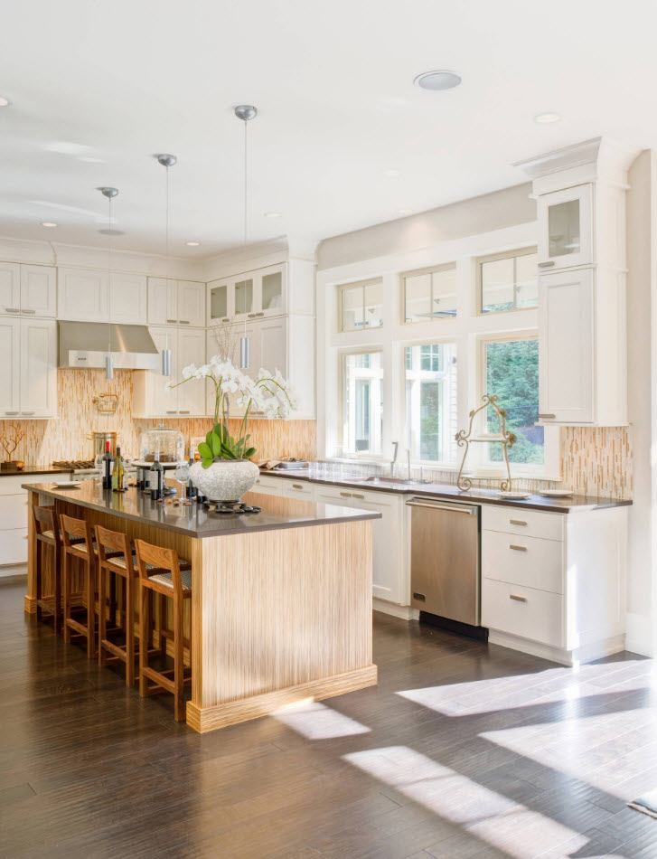 Classic light styled kitchen intrerior with wooden island