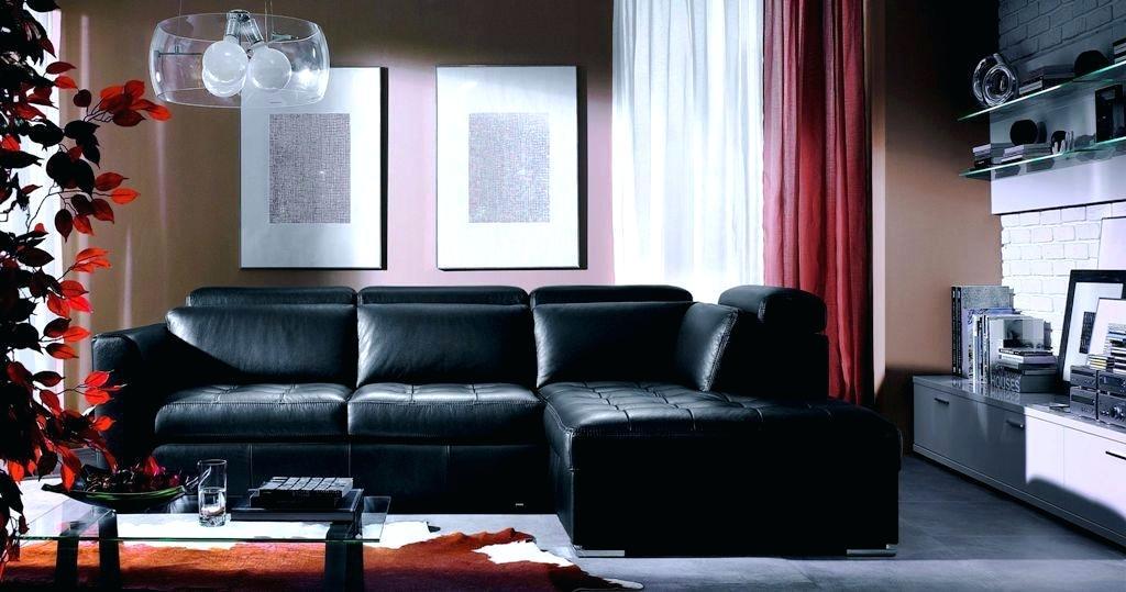 Black angular sofa with soft backrests