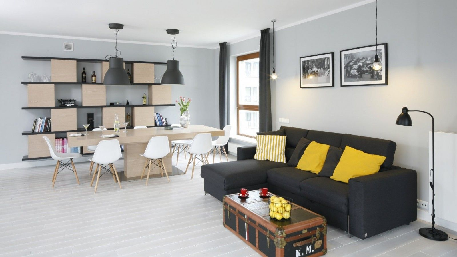Black Sofa: Elegant and Original Design for Flawless Interior. Yellow cushions as the accent in the open space living