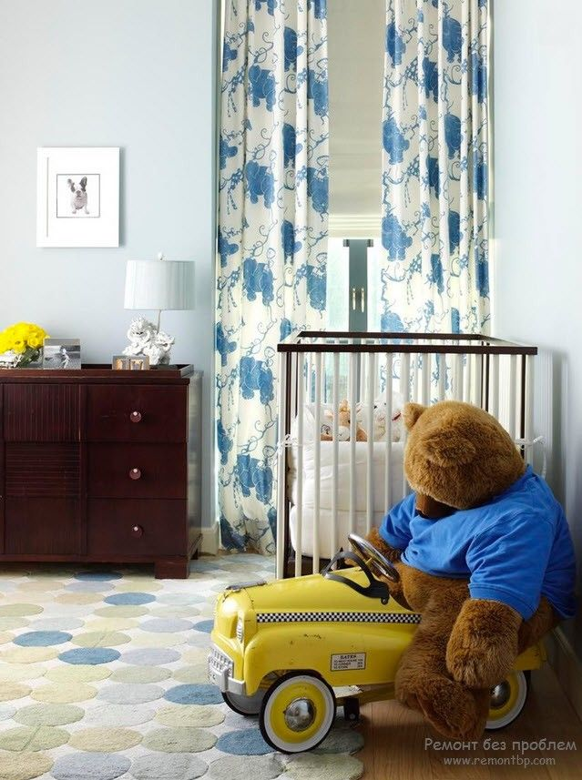Curtains in the Interior of the Children's Room. Dotted curtains and the teddy-bear in toy car