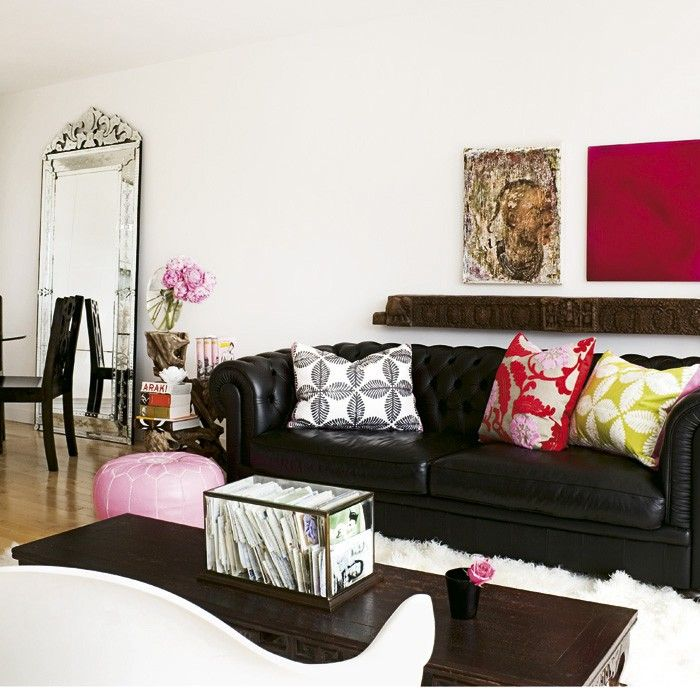 Black Sofa: Elegant and Original Design for Flawless Interior. Unusual coffe table and many colorful cushions