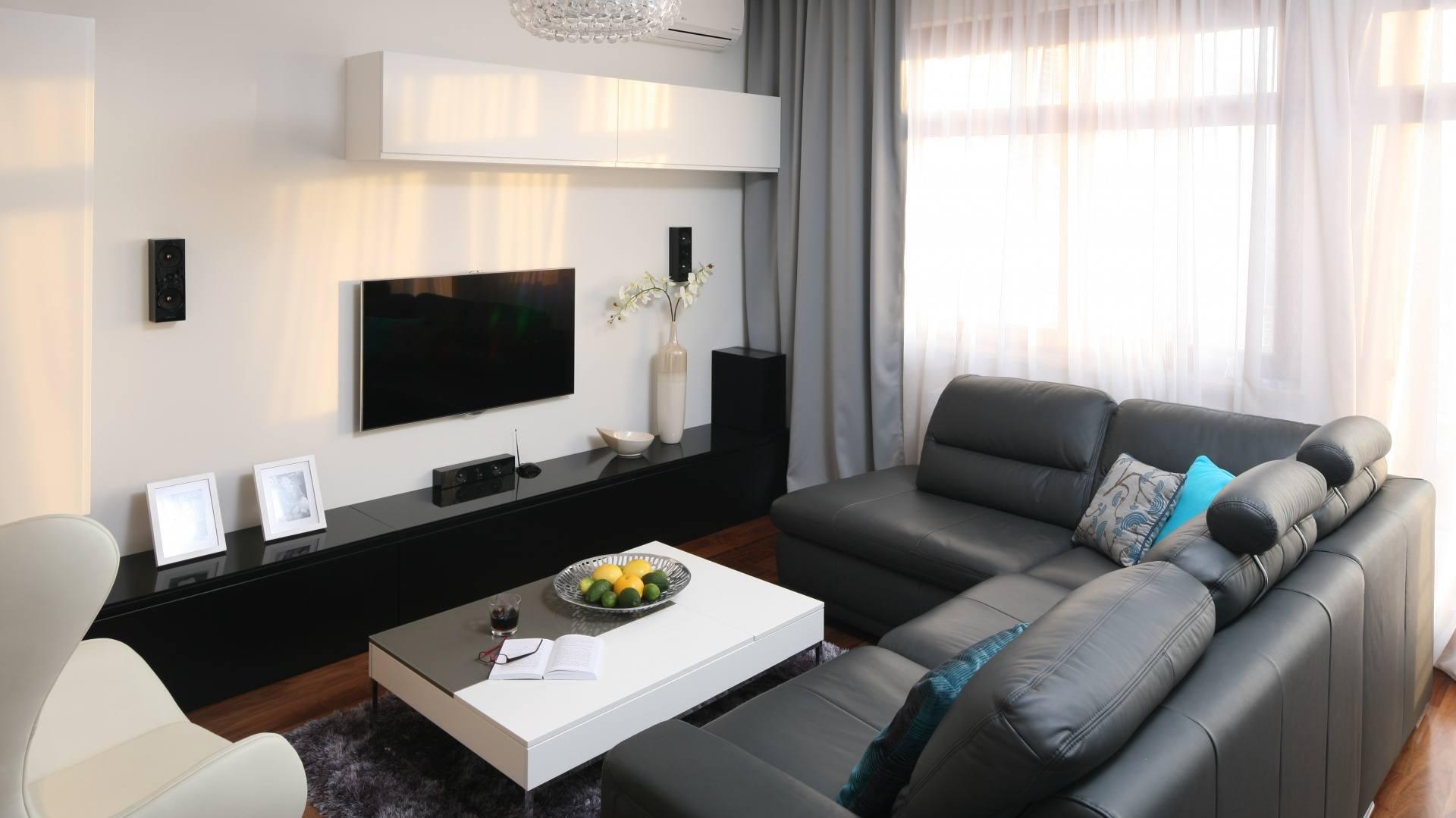 Modern designed living room with hovering shelves and TV-set