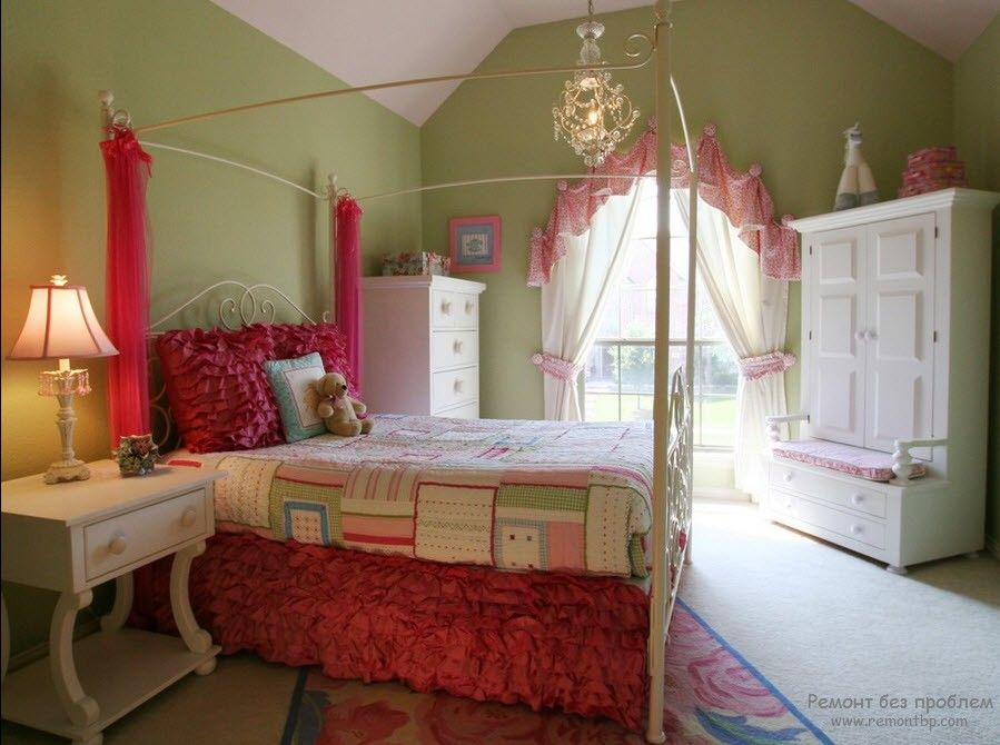 Curtains in the Interior of the Children's Room. Girlish interior with pink bed and green painted walls