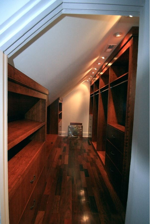 Attic Walk in Closet Ideas: Designing your Loft with Style and Functionality. Loft dressing room with wooden shelves and cabinets