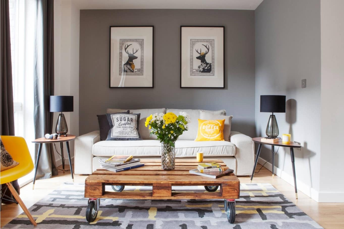 The Best DIY Hacks to Transform Your Home. Gray painted walls and pallet constructed coffe table in the living room