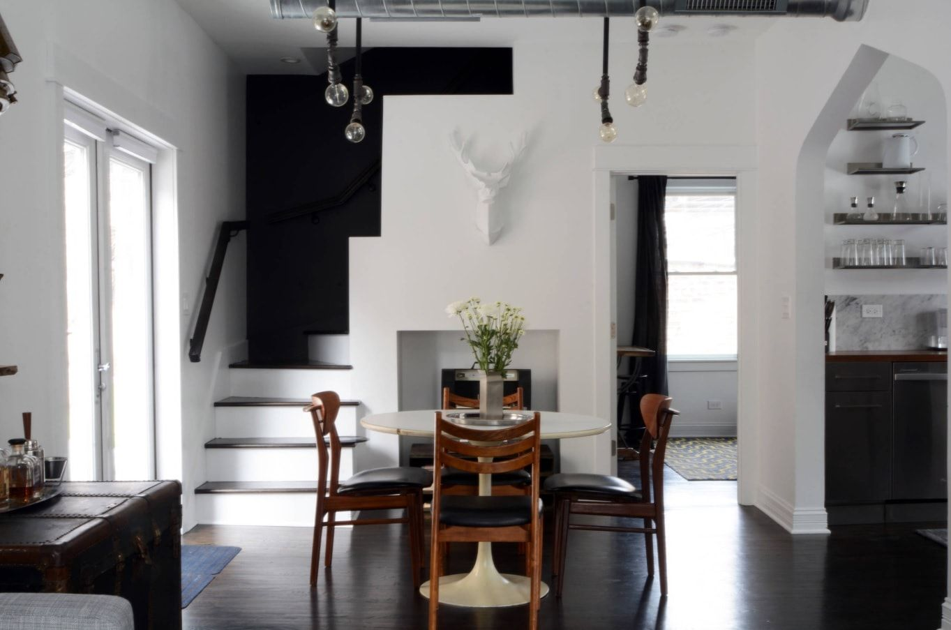 Black Dining Room Walls Effective Ideas for Authentic Interior. First floor dining zone with dark accent at the stairs