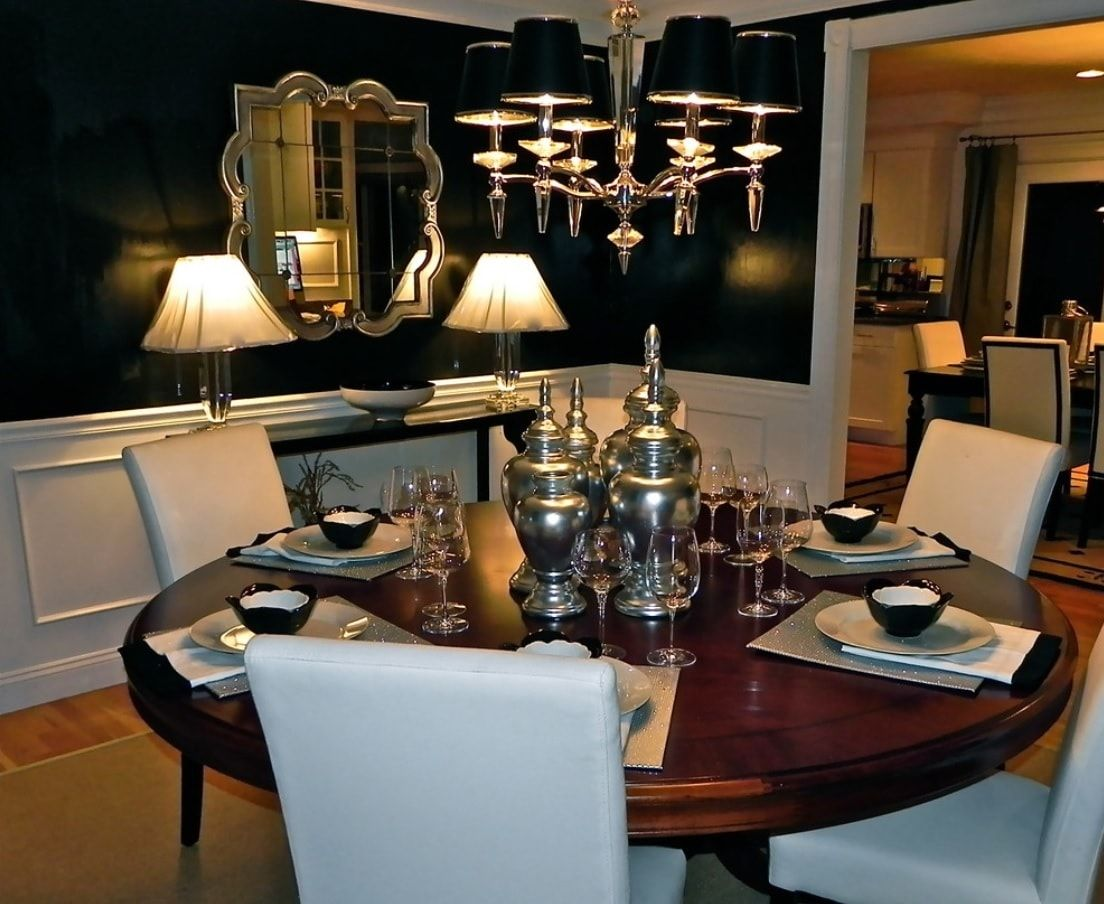 Black Dining Room Walls Effective Ideas for Authentic Interior. Unusual combination of silver plates and chromed mirror with dark glossy walls