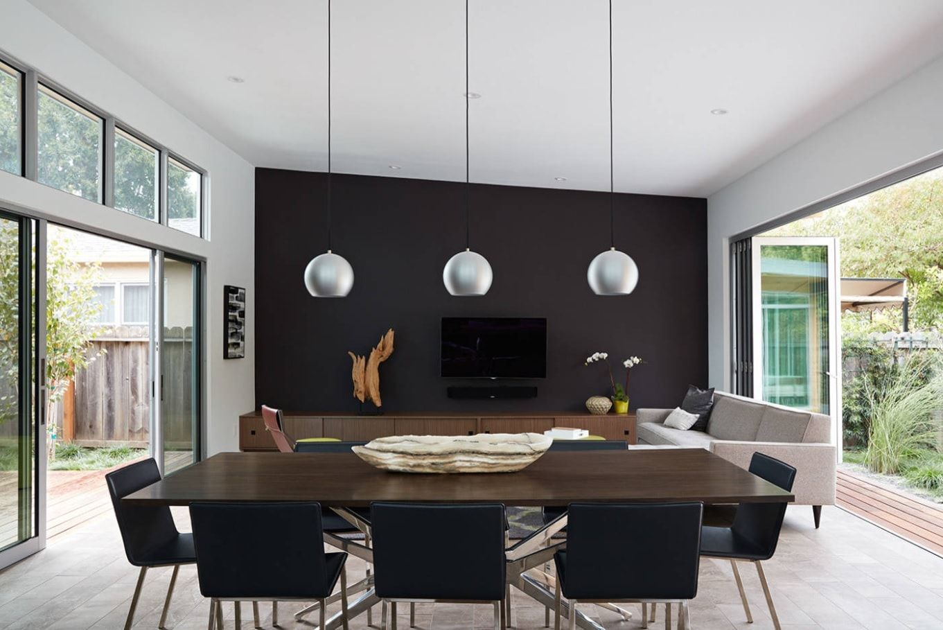 Contemporary styled house's appendix with black accent wall