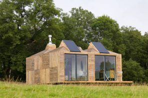 Switching Your Property To Solar Power: Why Do It. Wooden house at the open lawn