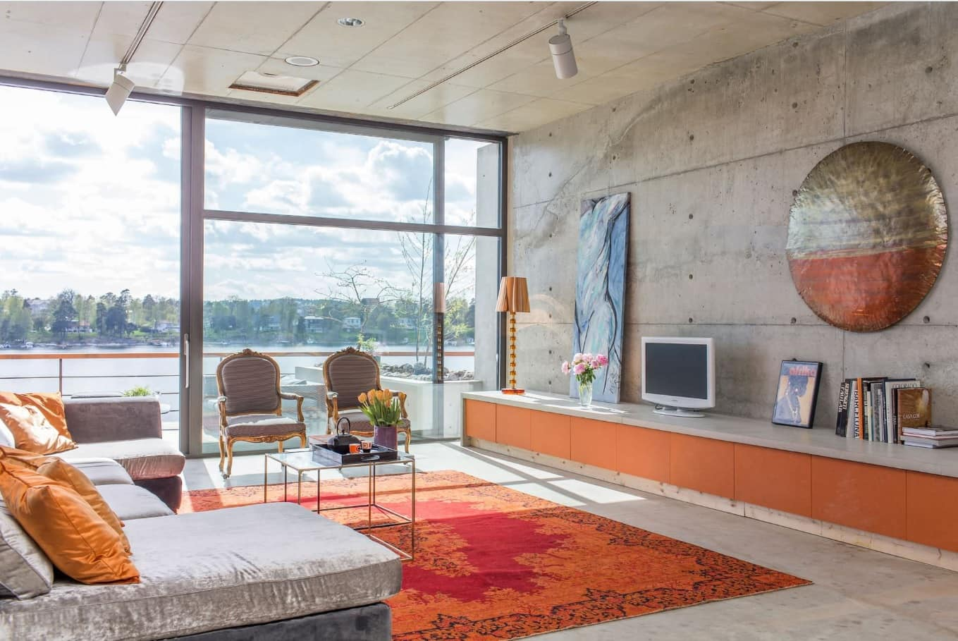 Faux Concrete Wall Paint: Modern and Original Finishing. Plates finished modern living room with panoramic window