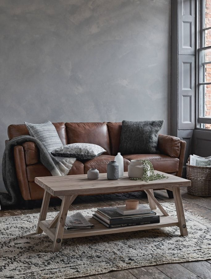 Faux Concrete Wall Paint: Modern and Original Finishing. Typical gray structure of concrete in the living room with minimum decoration