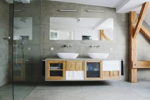 Faux Concrete Wall Paint: Modern and Original Finishing. Light asphalt colored bathroom with large mirror and airy hovering furniture