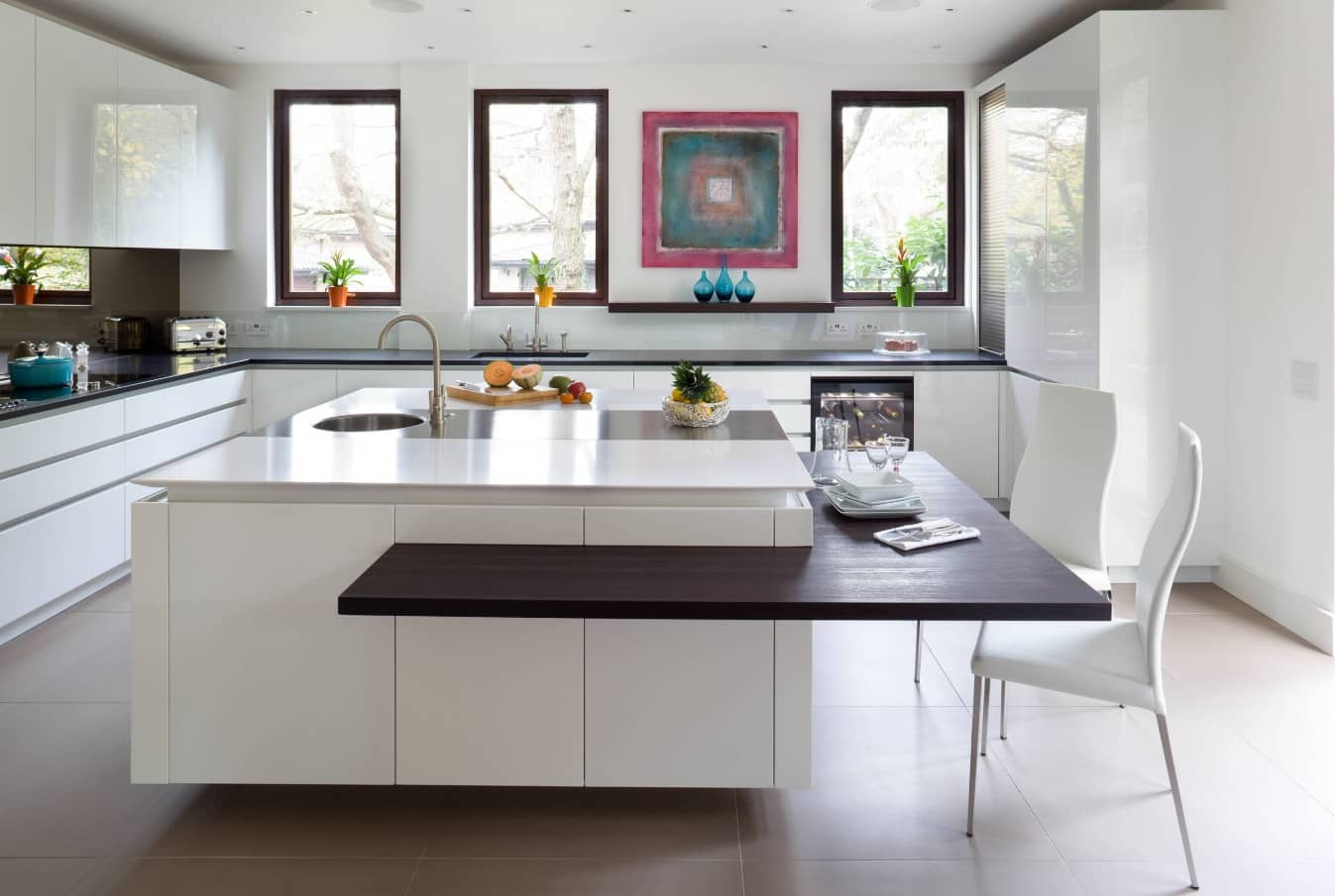 How to Pick the Best Colours for Your Kitchen. Unique space design with countertop for the big island