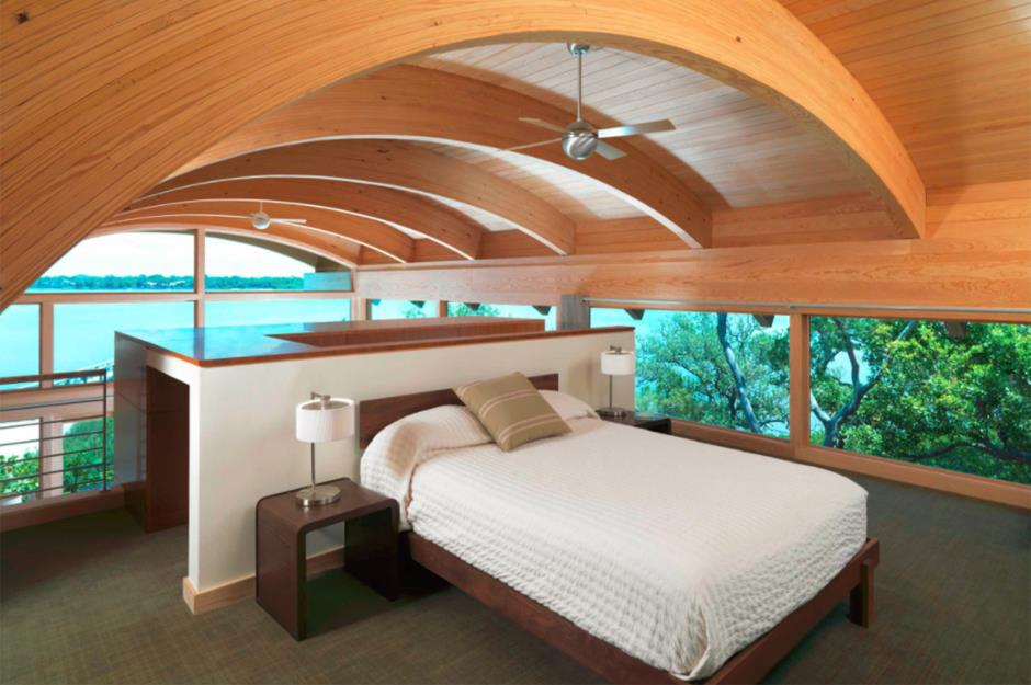 Attic Room Original Finishing and Decoration Ideas with Photos. Arched ceiling in the room with fan and platform bed