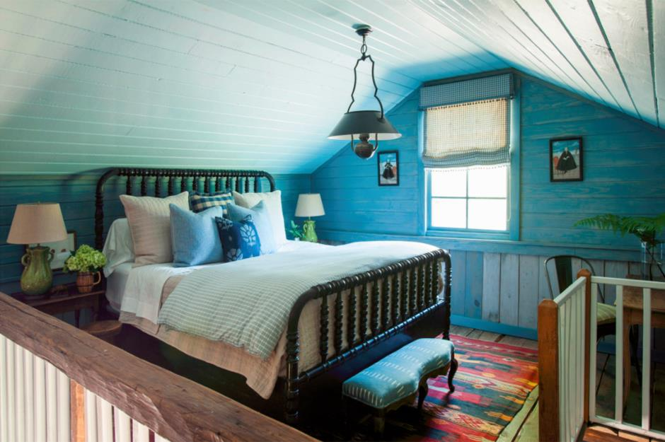 Fairy-tale turquoise bedroom with large metal-framed bed