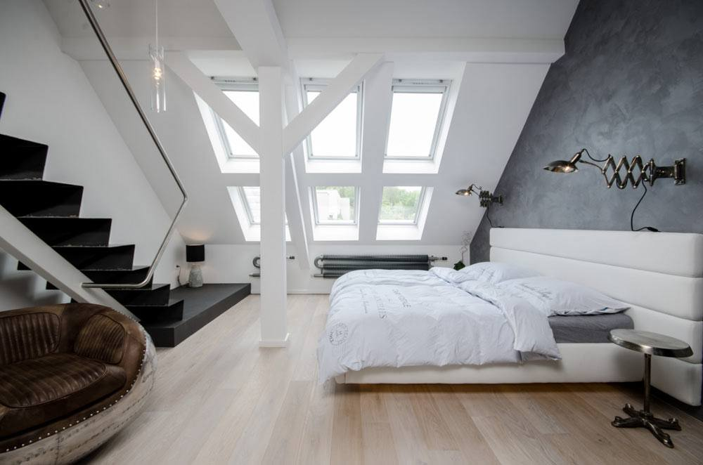 Gorgeous and practical designed bedroom at the attic with open bearing constructions colored in white