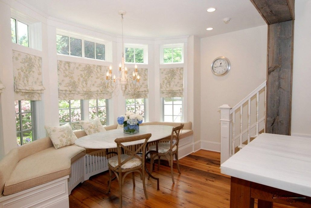 Light pastel colored dining zone at the stairs with wooden floor