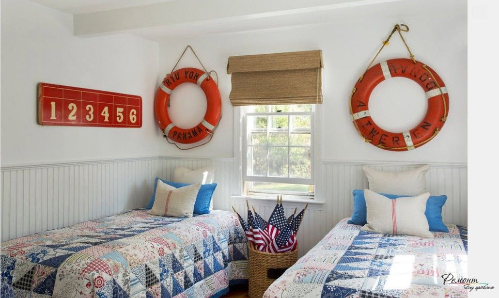 Marine styled room for children with lifebuoys as the decoration