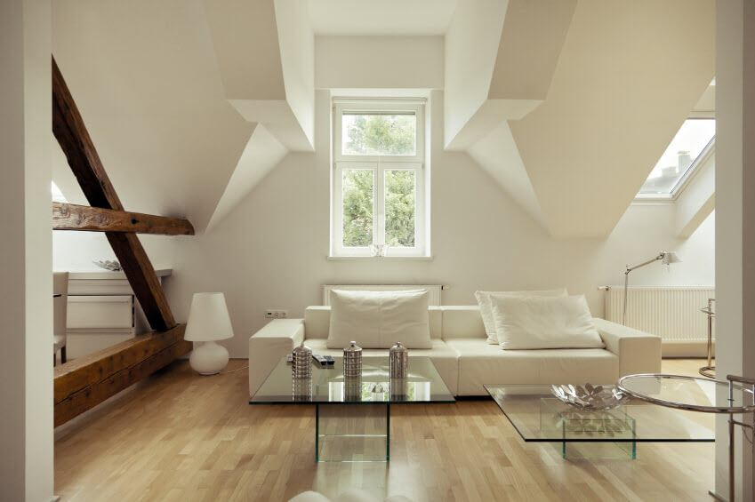 Complex geometry of the attic living room in modern style and pastel colors