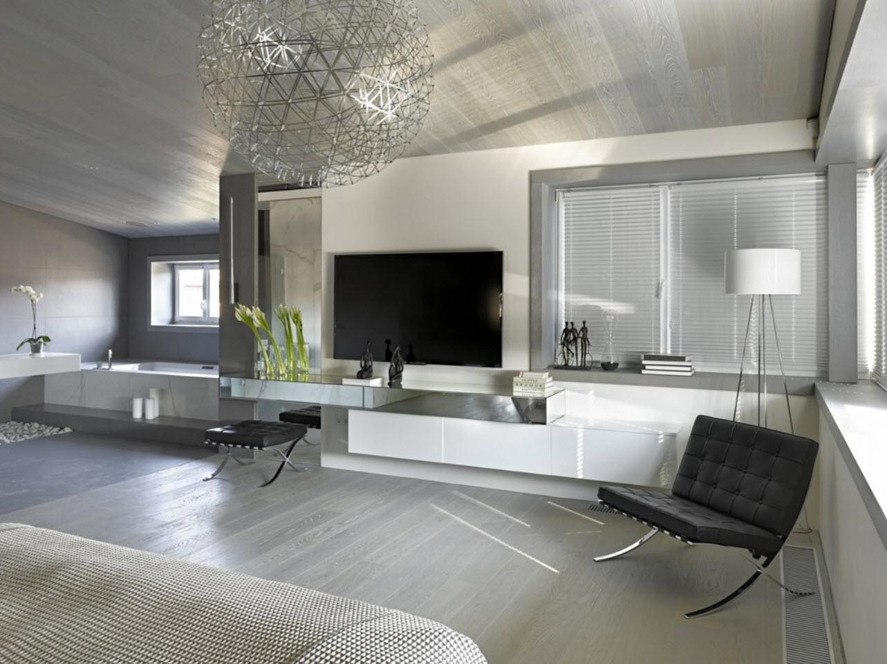 Silver and gray color theme for the large living room with modern furniture