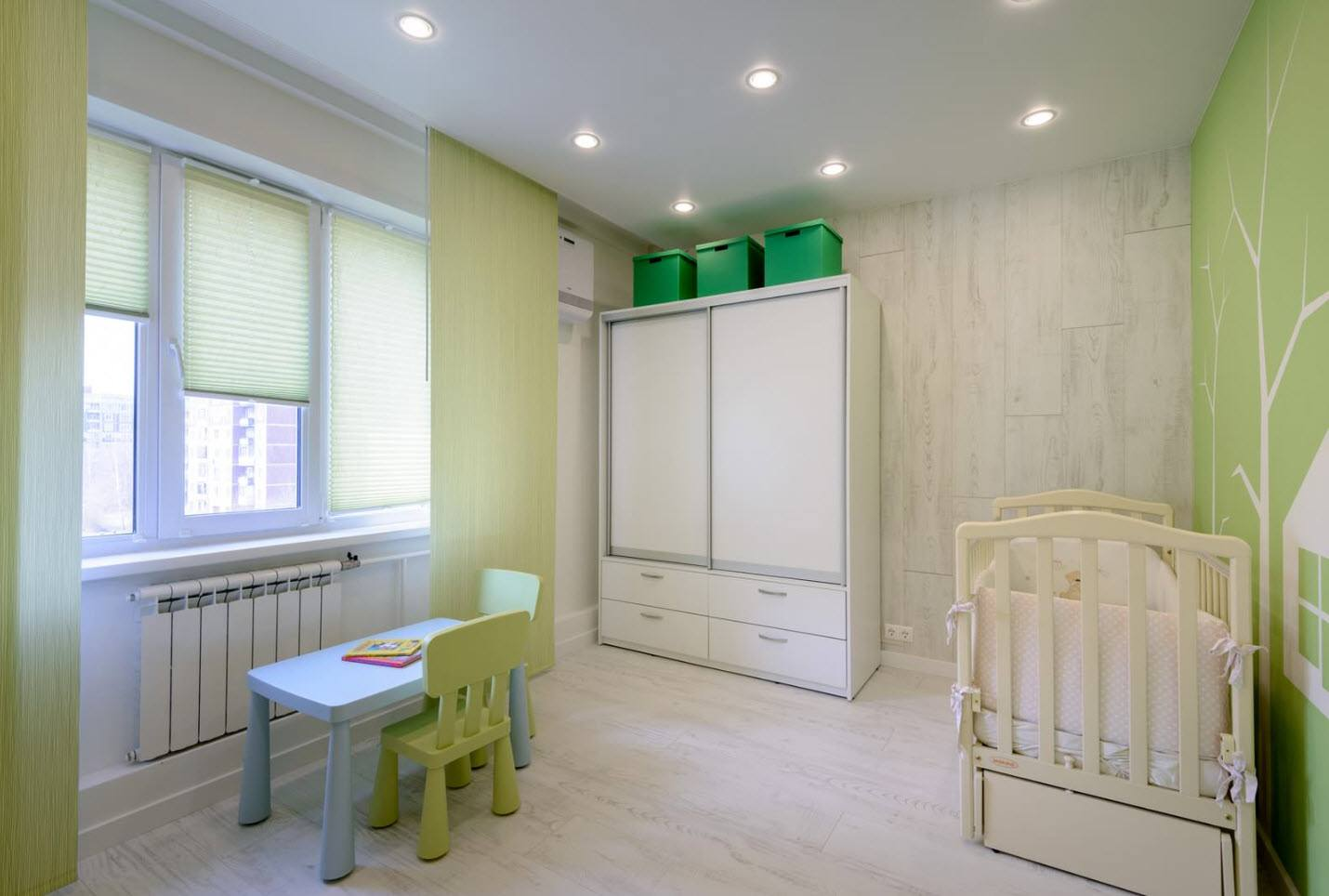 Small children's room for teenager with LED lighting, wooden furniture and green roller blinds