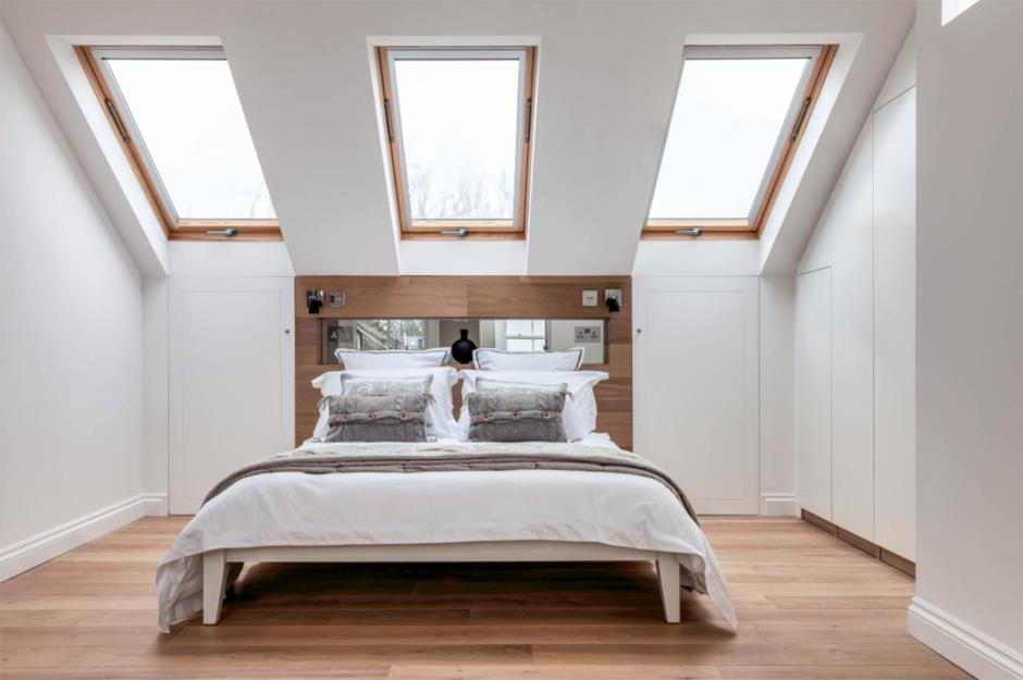 Attic Room Original Finishing and Decoration Ideas with Photos. Three skylights with wooden frames in the modern white colored interior