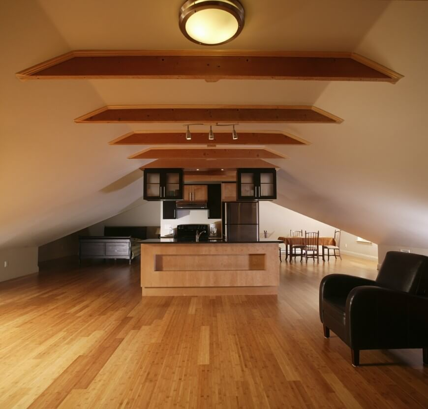 Large common space of the attic room in minimalism and light colors