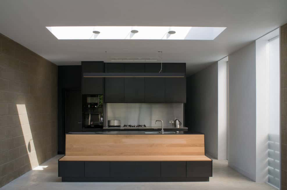 Black designed kitchen furniture with white walls and ceiling for ultramodern kitchen interior