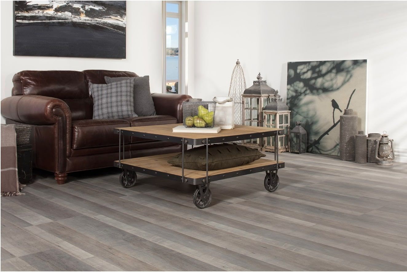Coffee table on castors as an accent in the casual styled room with leather upholstered sofa and gray laminate