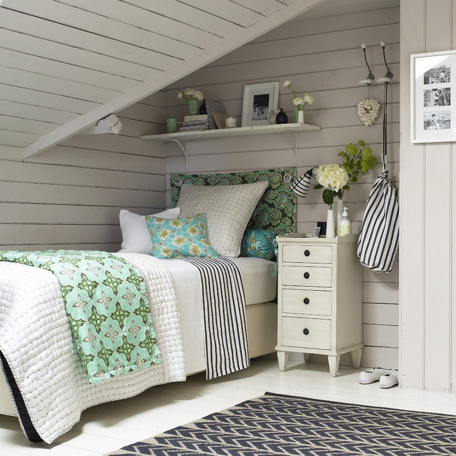 Wainscoting at the gray colored attic bedroom