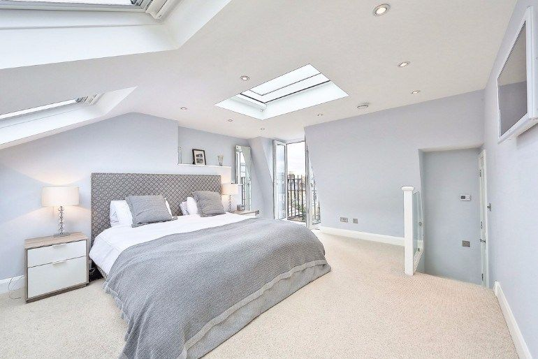 Attic Room Original Finishing and Decoration Ideas with Photos. Spacious mansard level with modern designed bedroom having light blue walls
