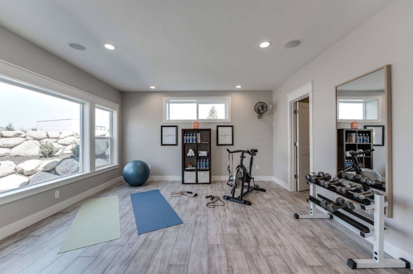 Gym at the spacious room with glossy floor and large windows
