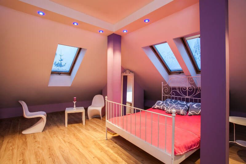 Attic Room Original Finishing and Decoration Ideas with Photos. Unusual neon lighting in the modern designed roof-space with the leisure zone