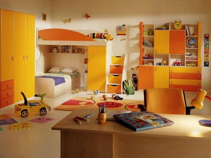 Choosing the Furniture for Children's Room: Arrangement for Boy, for Girl. Orange and yellow combination for the room filled with functional furniture