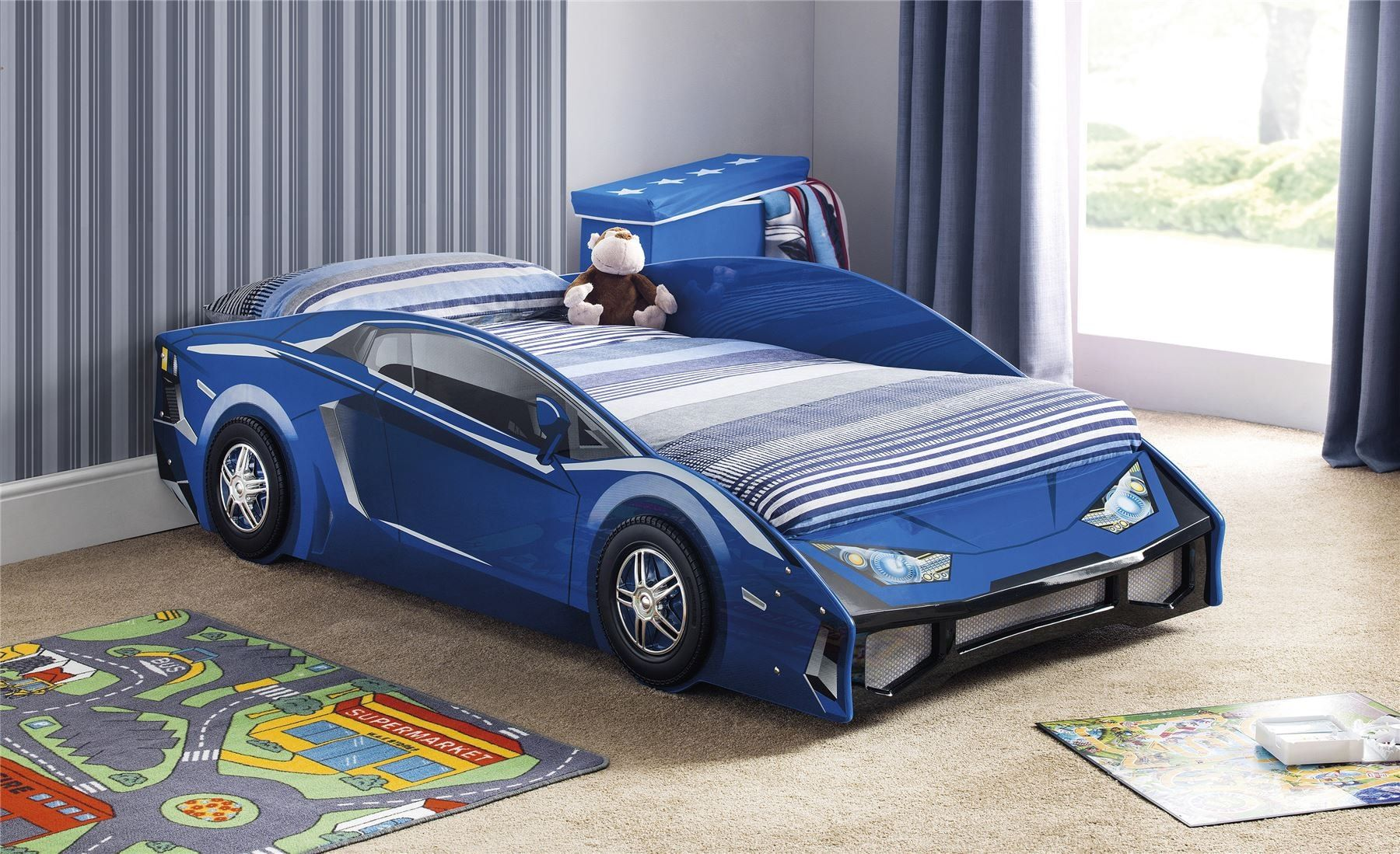 Car Beds for Children's Rooms: Bright Element of Interior Design. Classic sportive car in blue
