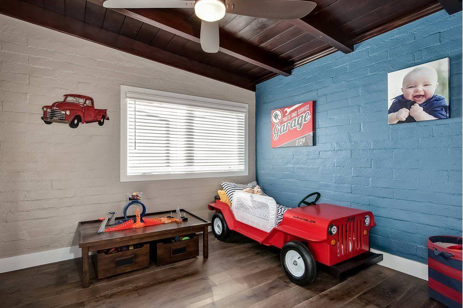 Car Beds for Children's Rooms: Bright Element of Interior Design. Dark ceiling, blue wall and the chest for little rascal