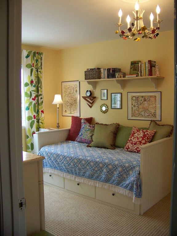 Small Room Interior Design Tips and Ideas. Yellow walls and the colorful curtains for small room with multifunctional bed