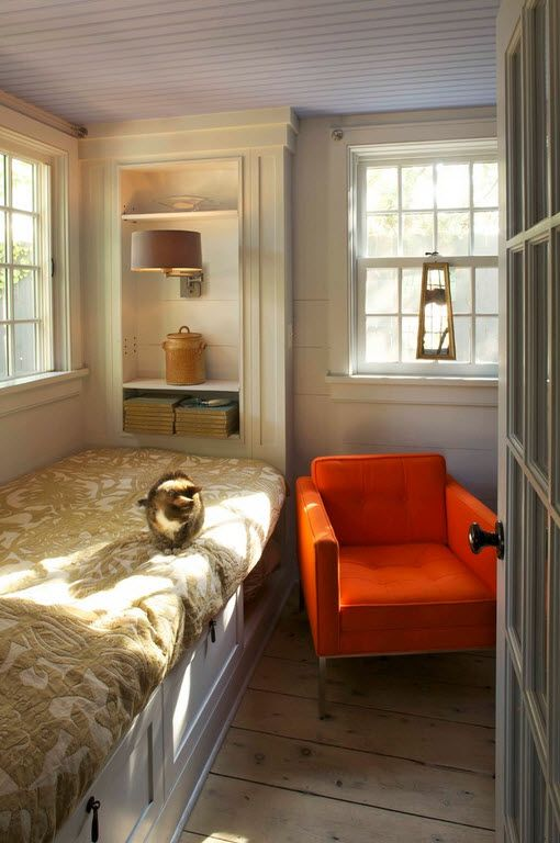Orange armchair for rustic designed bedroom with sash-windows