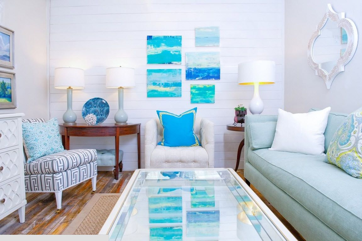 Unusual blue pictures and pillows decoration for the white room