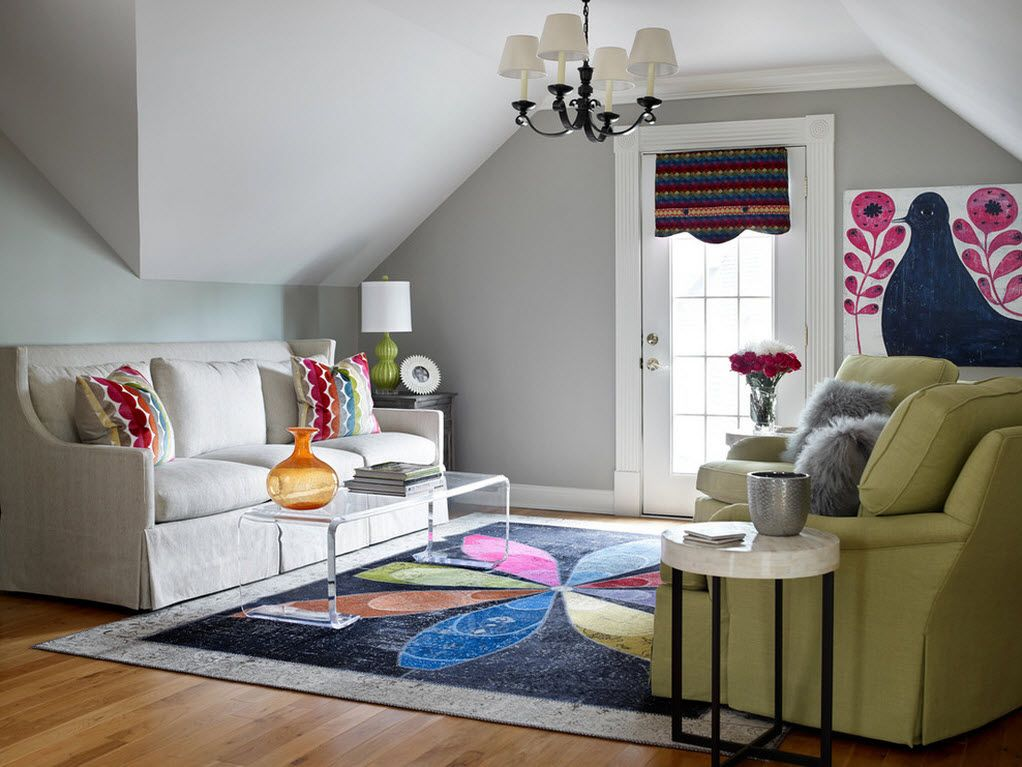 Small Room Interior Design Tips and Ideas. Small loft room with large white sofa and colorful carpet