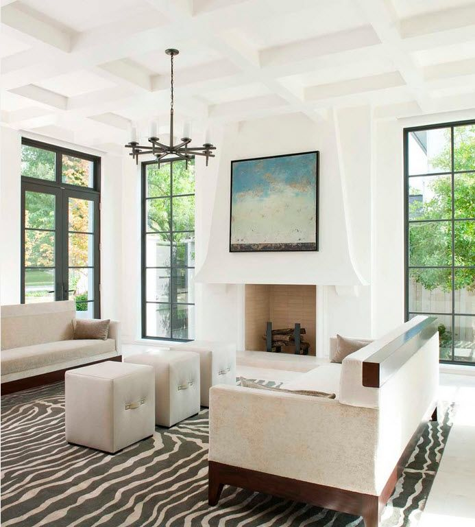 Absoultely white room with black framed windows and coffered ceiling