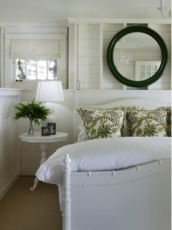 Round mirror and the bedside table for small bedroom