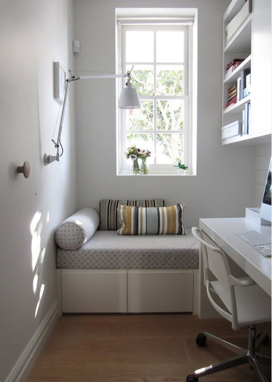 Gray color theme for small nook with sleeper at the window and pendant lamp