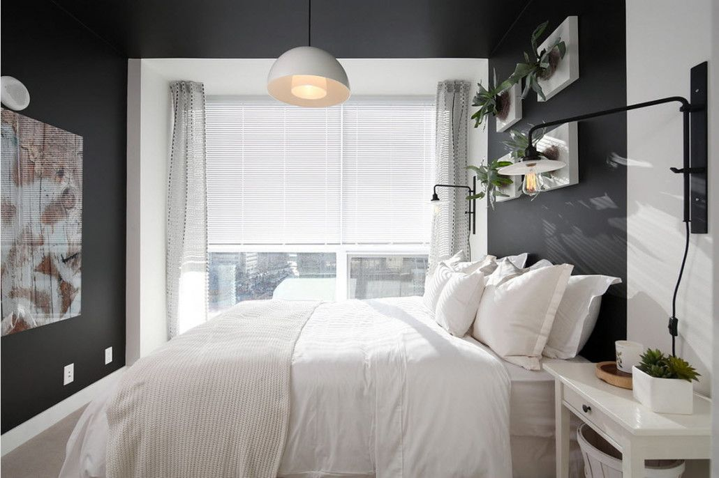 Gorgeous contrast in the casual styled room with dark walls and white bedding