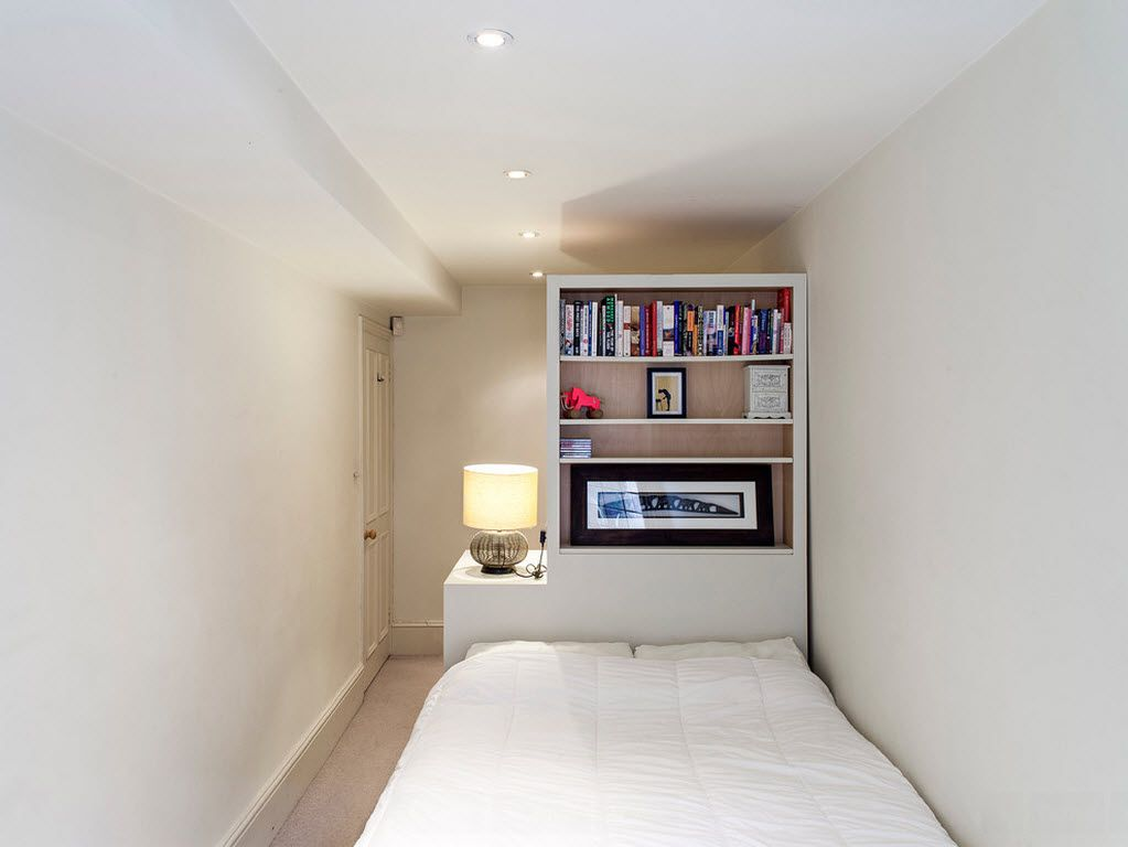 White functional bedroom with small working place