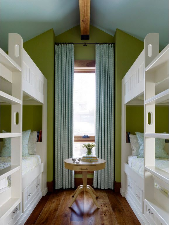 Gorgeous bedroom for four with two bunk beds and green accent wall